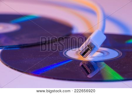 Closeup Of White Mini Displayport Cable With It's Reflection On Blank Disc