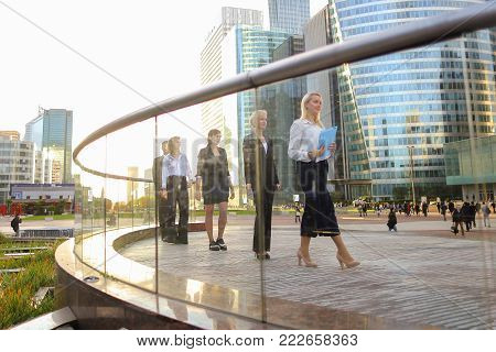Gladden management and financial colleagues passing in La Defense Paris,  . Concept of successful young people and business wear style.