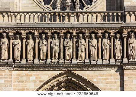 Architectural details of the catholic cathedral Notre Dame de Paris. Built in French Gothic architecture, Notre-Dame's facade showing Gallery of Kings. Paris, France