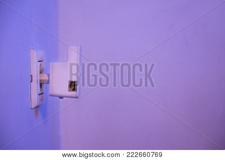 Wifi Repeater In Electrical Socket On The Wall
