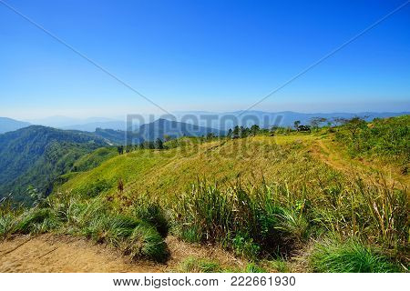 Mountain, forest and blue sky in Phu Chee Fa, Chiang Rai Thailand