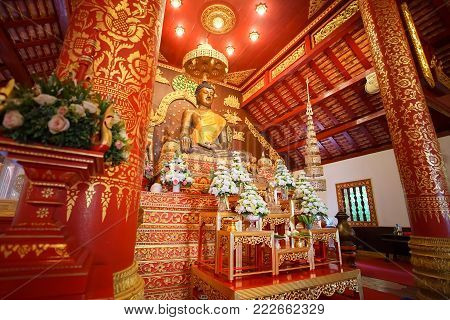 CHIANG RAI, THAILAND - December 20, 2017: Inside view of The chapel and the Bhudda image in Wat Phra Kaew Chiang Rai. It's a famous place for Chiang Rai trip.