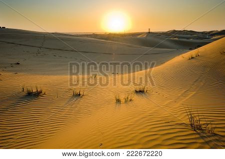 Sunset in the desert in the United Arab Emirates.