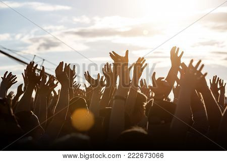 People silhouettes with raised up a human hands, Beach Party Summer Holiday Vacation Concept, With space for text