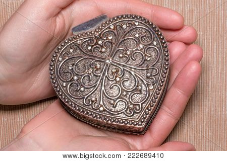 Old Vintage Silver Heart-shaped Casket On Gray Background. Isolated