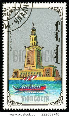 Ukraine - circa 2018: A postage stamp printed in Mongolia show Lighthouse of Alexandria. Series: 7 Wonders of the Ancient World. Circa 1990.