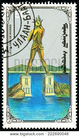 Ukraine - circa 2018: A postage stamp printed in Mongolia show Colossus of Rhodes. Series: 7 Wonders of the Ancient World. Circa 1990.