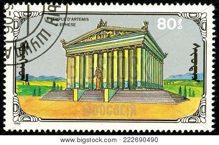 Ukraine - circa 2018: A postage stamp printed in Mongolia show Temple of Artemis. Series: 7 Wonders of the Ancient World. Circa 1990.