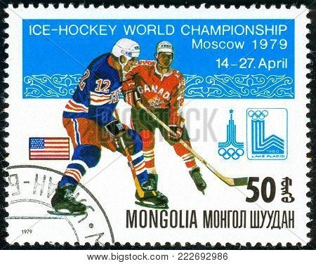 Ukraine - circa 2018: A postage stamp printed in Mongolia show hockey with the puck. A players in the uniform of U.S.A., Canada. Flag U.S.A. Series: Moscow ice hockey world championships. Circa 1979.