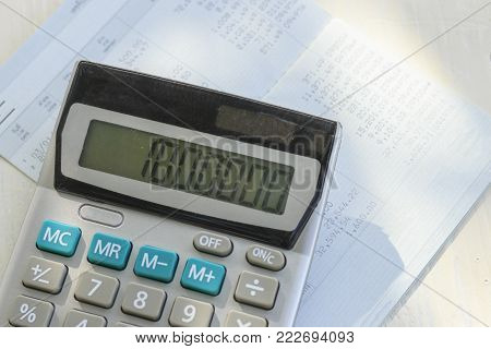 Saving account book or financial statement and calculator,Business, finance, saving money or investment concept.