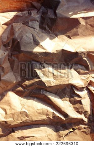 A grunge recycle brown paper texture for background use.