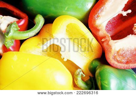 Colourful green, red and yellow peppers in a close up photo. A colourful background concept.
