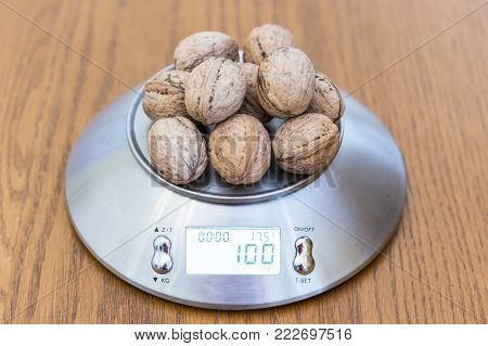 One hundred grams of walnuts on the scales
