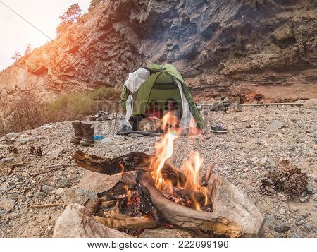 Trekkers Couple Inside Tent Camping In Rock Mountains With Their Dog - Sporty People Relaxing After