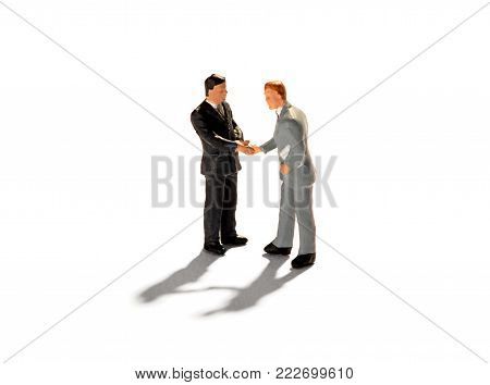 Two Miniature Figures Of Businessmen
