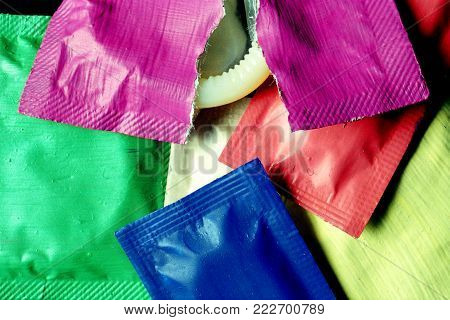A Close Up Photo Of Colorful Condom Packs.