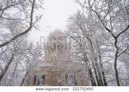 Lookout tower in Budapest covered by snow