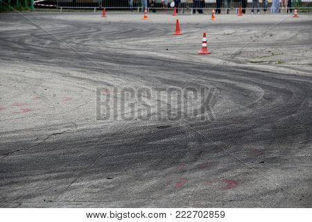 Drift track with tires traces between safety cones