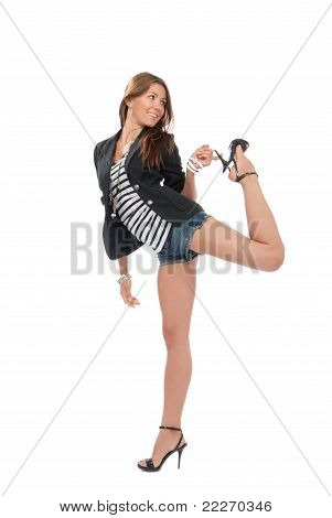 Happy young beautiful full body brunette woman dancing in casual cloth smiling on a white background poster