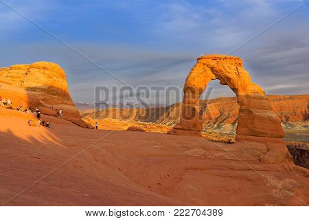 Delicate Arch, UT, USA, June 05 2015 : Tourists and photographers wait for the light at Delicate Arch.
