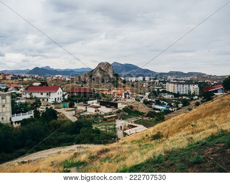 city of Sudak in the Crimea on holiday in the summer in cloudy weather