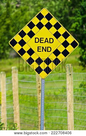 Closeup of a checkered Dead End sign. Dead end sign in the desert.