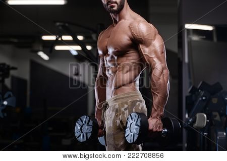 Sexy Strong Bodybuilder Athletic Men Pumping Up Muscles With Dumbbells