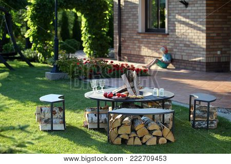 Garden furniture in beautiful, summer garden.