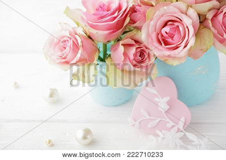 pink rose flowers in a vase and pink heart. shabby chic colors