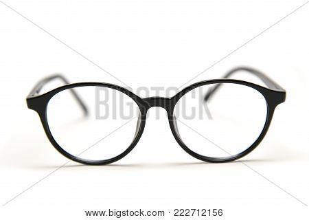 Correcting glasses isolated on white background, close up sharpness on eyepieces