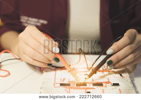 Woman with voltmeter, Woman measuring electrical current