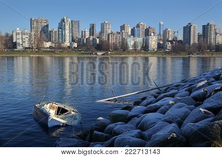 English Bay Shipwreck, Vancouver. A sunken sailboat the day after a storm hits Vancouver, British Columbia.