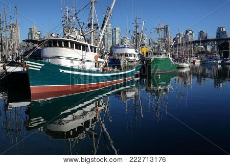 False Creek Fishermen's Wharf. Fish boats at Vancouver's Fishermen's Wharf near Granville Island. British Columbia, Canada.