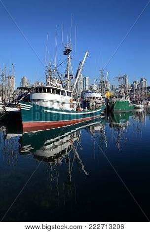 False Creek Fishermen's Wharf vertical. Fish boats at Vancouver's Fishermen's Wharf near Granville Island. British Columbia, Canada.