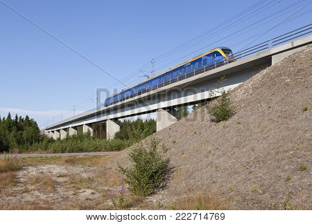 NORTH COUNTY, SWEDEN ON JULY 24. Intercity train heading south on July 24, 2014 in North County, Sweden. Modern track through the countryside. Editorial use.