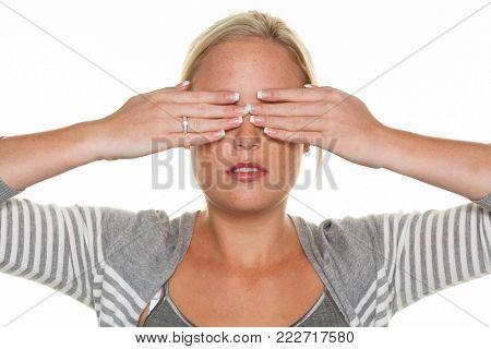 woman keeps her eyes closed