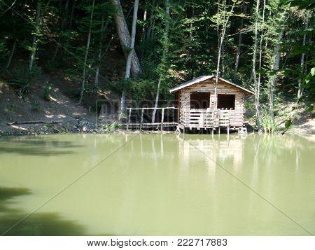 Yalta, Crimea, Russia - JULY 14, 2012: Wild house on the lake in the mountains Crimea