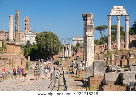 ROME,ITALY - JULY 18,2017 : Tourists visiting the ruins of the ancient Roman Forum