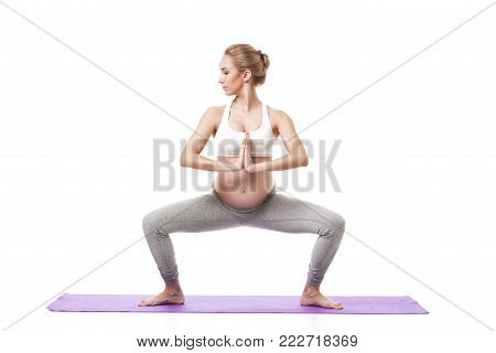 Full Body Portrait Of Pregnant Woman Doing Yoga On a Purple Exercise Mat. isolated on white background