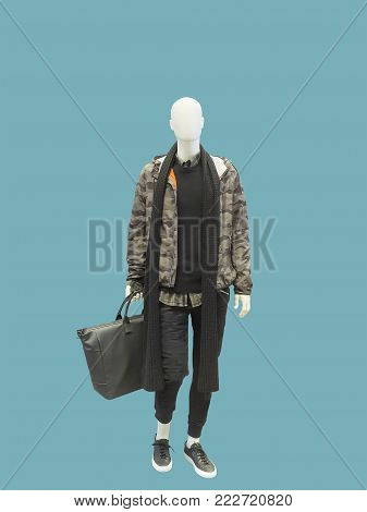 Full-length male mannequin dressed in jacket with hood, isolated on green background. No brand names or copyright objects.