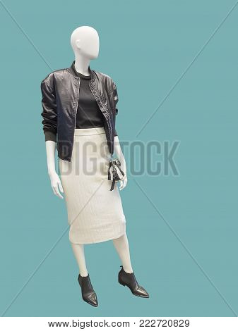 Full-length female mannequin wearing black leather jacket and white skirt, isolated. No brand names or copyright objects.