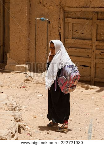 A girl dressed in black returns from school on May 4, 2007 in Al Hajarayn, Yemen. Although infant mortality is high, children in Yemen are culturally, socially and religiously valued.