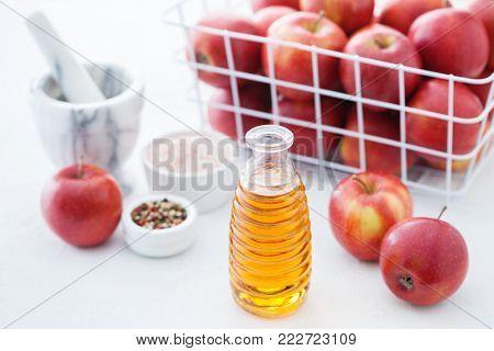 bottle of apple vinegar on kitchen table - food and drink