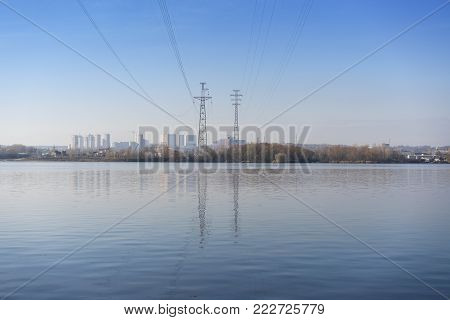 High-voltage wires are laid over the river