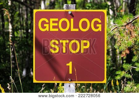 A Geolog Stop sign at a park.