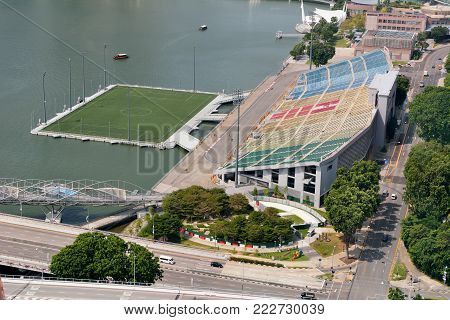 Singapore, Singapore - December 11, 2017. View over the Float at Marina Bay stadium and stage in Singapore, with surrounding buildings and city traffic.