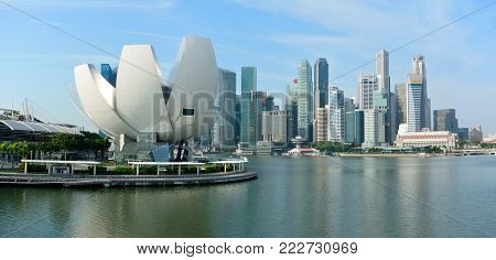Singapore, Singapore - December 11, 2017. Skyline in Singapore with flower-shaped ArtScience Museum and skyscrapers.