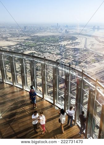 DUBAI, UAE - OCTOBER 26, 2017: People at the top of Burj Khalifa tallest tower in the world