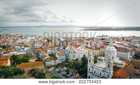 Aerial landscape view of the front of the Basilica da Estrela and Madragoa and Bairro Alto neighbourhood.Beautiful Mediterranean capital city of Portugal, Lisbon.