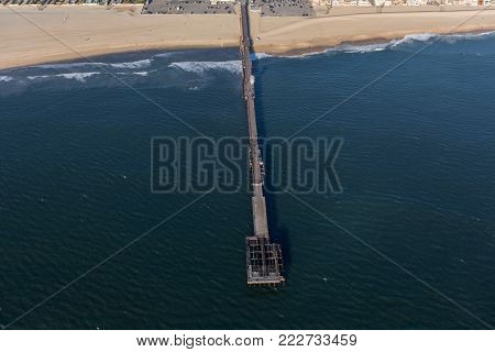 Aerial view of fire damaged Seal Beach Municipal Pier in Orange County, California.